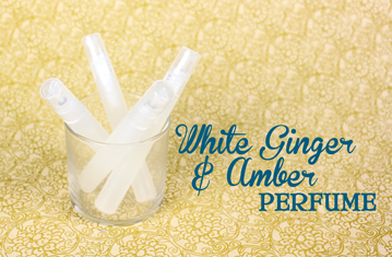 White Ginger and Amber perfume in a mini spray bottle